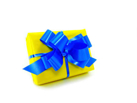 yellow gift box with blue robbon isolated on white                                Stock Photo