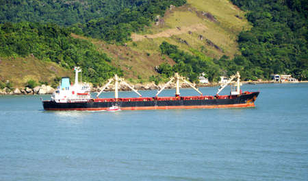 cargo ship departure from the port of the city of santos in brazil                    photo