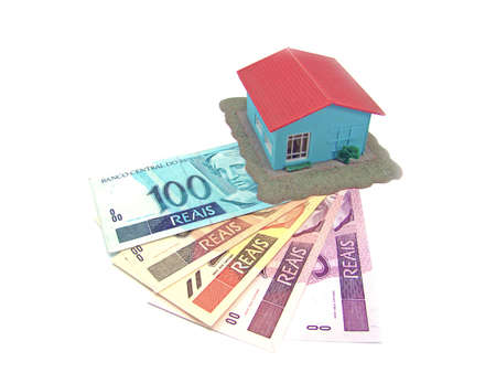 little model: little model house over a lot of brazilian real banknote                                Stock Photo