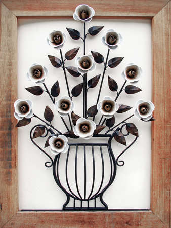 metal made flower and vase with wood frame photo
