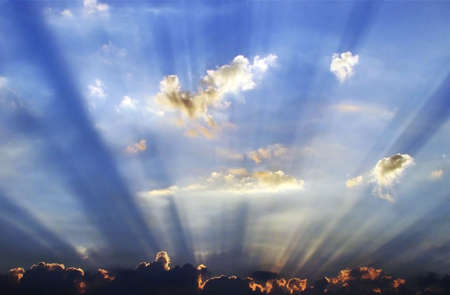 sunrays emerging behind the cloud Imagens