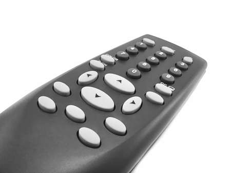 a black remote control against white background photo
