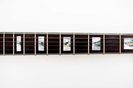 frets: Detail of electric guitar neck and frets on white background