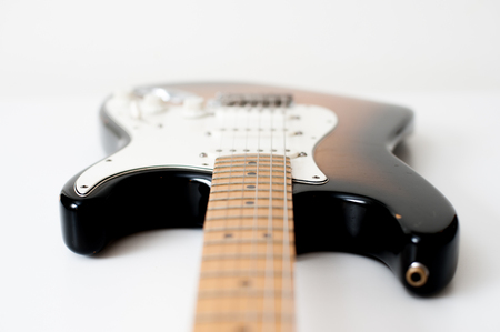 out of body: Detail of brown electric guitar body with out of focus