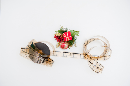 hollywood christmas: Film reel with christmas decoration isolated on white background