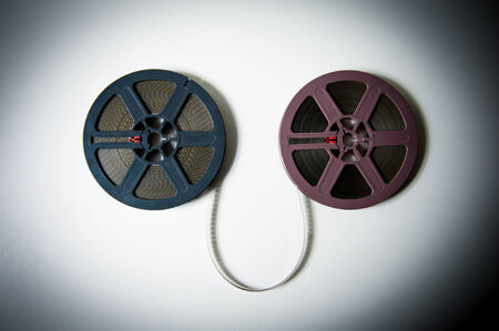 super 8: Couple of gray and purple 8mm super 8 movie reels on white background, vintage look and color effect Stock Photo