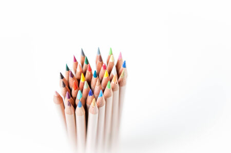 Bunch of pencil with wooden body and colored tips, vertical, pointing up, focus on selected bunch center photo