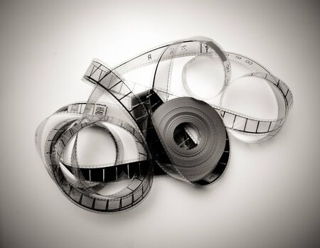Unrolled 35mm movie reel in vintage black and white and light effect photo