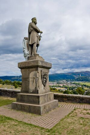 Robert the Bruce statue view from the castle in  Scotland, Stirling, vertical and panorama in background
