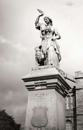 macdonald: Black and white vintage effect of Flora Macdonald statue Inverness, Scotland, cloudy day Editorial