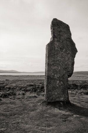 obelisk stone: Stenness stone circle view in Orkney island, Scotland black and white stone closeup Stock Photo