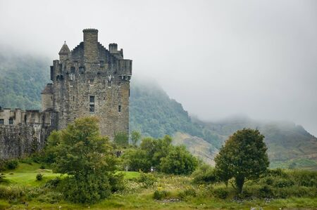 drawbridge: View of Eileen Donan Castle, Scotland in cloudy day with dramatic light