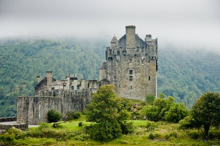 the jacobite: View of Eileen Donan Castle, Scotland in cloudy day with dramatic light