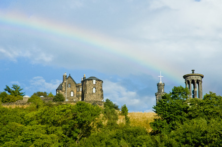 View of Dugald Stewart monument from the city with rainbow, Edinburgh, Scotland