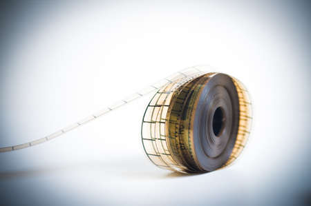 35mm: 35mm movie reel, unrolled with selective focus, vintage color look and feel and copyspace