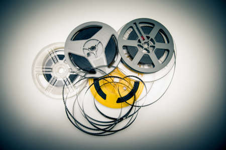 super 8: Heap of super 8 mm movie reels  different colors, old condition objects and vintage color effect Stock Photo
