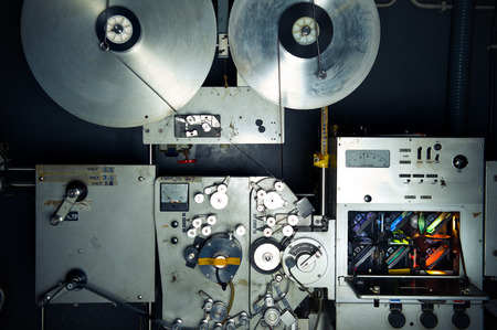 35 mm: Movie printer industrial machine for 35 mm film, analog optical process with rgb lamps and reels in a post production factory Stock Photo