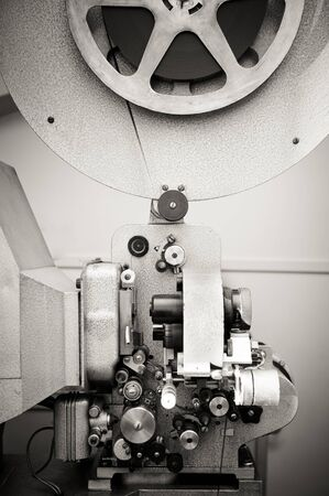 16mm: Cinema projector for 16 mm movie, old vintage  professional industrial machine with reel in black and white
