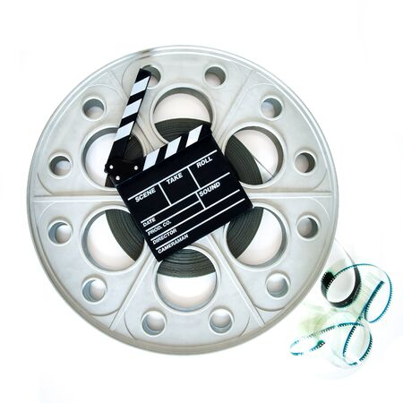 35 mm: Original old big movie reel for 35 mm cinema projector loaded with film, with clapper board on neutral background, square format
