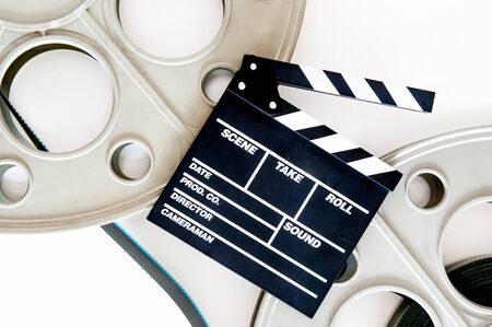 35 mm: Two movie reels for 35 mm film projector with clapper board and filmstrip on neutral background Stock Photo