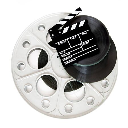 35 mm: Movie clapper on 35 mm cinema film reels isolated on white background square frame