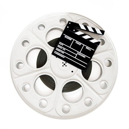 Movie clapper on 35 mm cinema film reel isolated on white background square frame photo