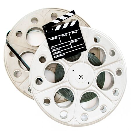 35 mm: Movie clapper on two 35 mm cinema reels with film isolated on white background