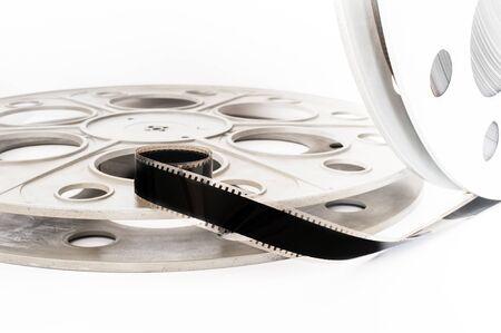 35 mm: Vintage 35 mm movie cinema reel on white background film unrolled