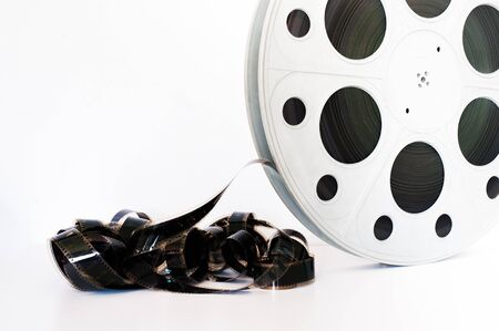 35: Vintage 35 mm movie cinema reel on white background film unrolled and copy space Stock Photo