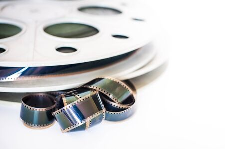 35 mm: Vintage 35 mm movie cinema reel on white background film unrolled, selective focus Stock Photo