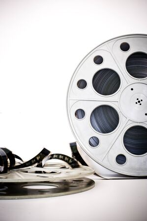 35 mm: 35 mm movie cinema reels with film unrolled vertical frame on white background Stock Photo