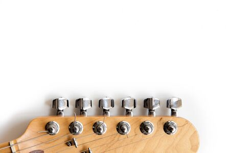 finer: Electric guitar wooden color headstock in horizontal position detail on white background