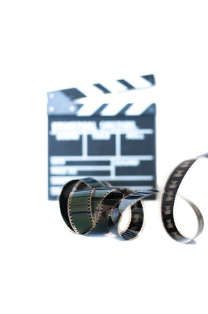 35 mm: Movie clapper and 35 mm film isolated vertical frame selective focus