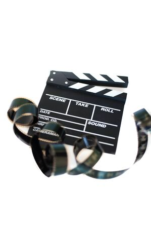 35 mm: Movie clapper and 35 mm film isolated on white background filmstrip unrolled vertical frame