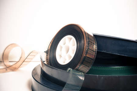 35: Vintage 35 mm movie reel and boxes on white background