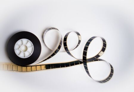 35 mm: Unrolled 35 mm movie film on white background vintage color effect Stock Photo