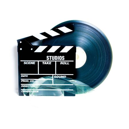 35 mm: Movie clapper board and 35 mm film reel on white background vintage color effect