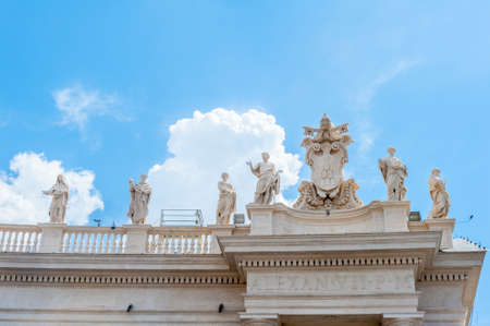 bernini: View of St Peter square statues up on Bernini39s colonnade Vatican symbol sunny day