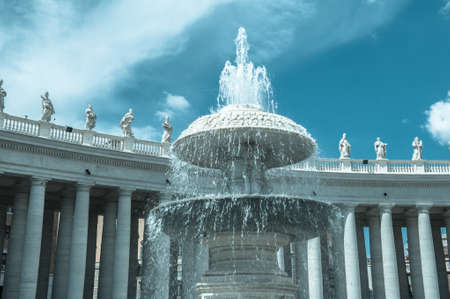 bernini: One fountain in St Peter square in Rome Italy colonnade in the background