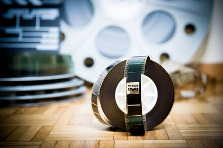 35 mm: 35 mm cinema movie filmstrip with picture start frame and other movie objects background Stock Photo