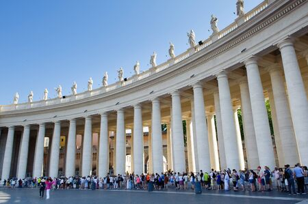 papal audience: ROME, ITALY, VATICAN CITY JULY 4th 2015. Pilgrims and tourists under colomnade queue waiting to enter in St. Peter Basilica, Vatican City, St Peter square Editorial