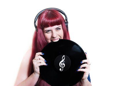 sound bite: Young pretty woman with headphones biting vinyl disk isolated on white background