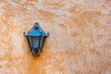 garden lamp: Outdoor garden lamp on rough coarse orange wall
