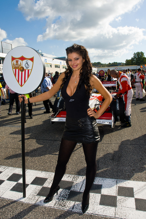 starting line: VALLELUNGA CIRCUIT, ROME, ITALY - NOVEMBER 2 2008. Grid girl and superleague formula car on circuit starting line