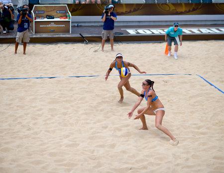 world championships: ROME, ITALY - JUNE 14 2011. Beach volleyball world championships. Italian team Marta Menegatti and Greta Cicolari in action Editorial