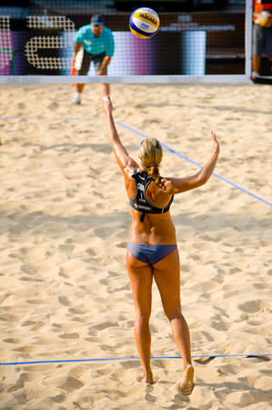 world championships: ROME, ITALY - JUNE 15 2011. Beach volleyball world championships. England player Denise Johns serve during a match Editorial