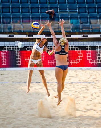world championships: ROME, ITALY - JUNE 15 2011. Beach volleyball world championships. Italian player Marta Menegatti and england player Lucy Boulton during a match