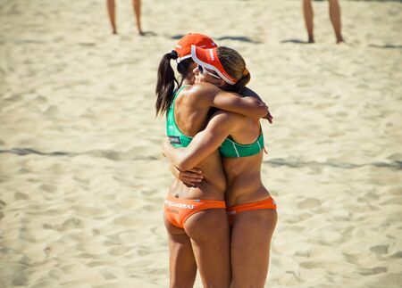 silva: ROME, ITALY - JUNE 18 2011. Beach volleyball world championships. Brazilian women players Juliana Silva and Larissa França happy after closing semifinal