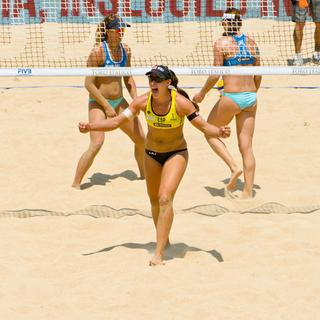 world championships: ROME, ITALY - JUNE 16 2011. Beach volleyball world championships. Spanish player Liliana Fernandez cry after winning point