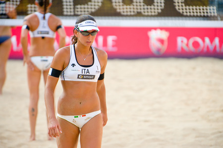 world championships: ROME, ITALY - JUNE 15 2011. Beach volleyball world championships. Italian player Marta Menegatti during a match Editorial